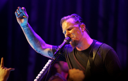 """Metallica's James Hetfield performs with the band during at a party for the film """"The Darwin Awards"""" at the Sundance Film Festival  in Park City, Utah, Wednesday, Jan. 25, 2006. Metallica appeared in the film.  (AP Photo/Carolyn Kaster)"""