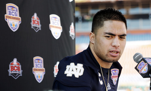 FILE - In this Jan. 5, 2013, file photo, Notre Dame linebacker Manti Te'o answers a question during media day for the BCS national championship NCAA college football game in Miami. The wrenching story of Te'o's girlfriend dying of leukemia, a loss he said inspired him to play his best all the way to the BCS championship, was dismissed by the school Wednesday, Jan. 16, as a hoax perpetrated against the linebacker. (AP Photo/David J. Phillip, File)