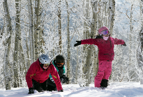 Francisco Kjolseth  |  The Salt Lake Tribune Visiting all the way from Melbourne, Australia, Sarah, 11, and Harry Gregor, 10, and Louisa Chong, 9, from left, play in the snow at the top of the Payday lift on Monday, December 31, 2012. Skiers took to the slopes of Park City Mountain Resort on the last day of the year.