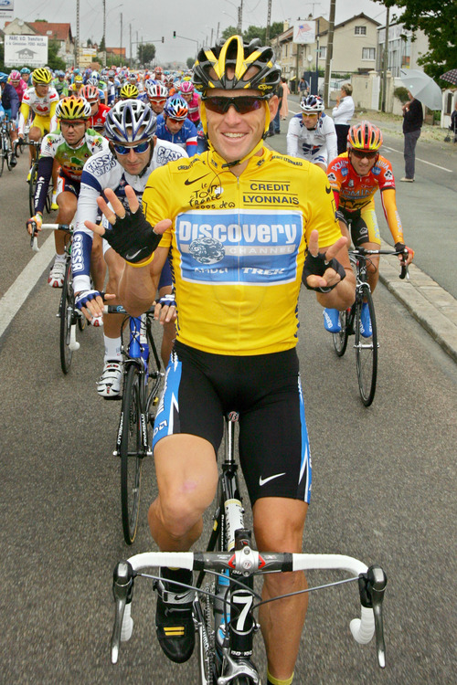 """FILE - In this July 24, 2005, file photo, overall leader Lance Armstrong signals seven for his seventh straight win in the Tour de France cycling race as he pedals during the 21st and final stage of the race between Corbeil-Essonnes, south of Paris, and the French capital. Armstrong confessed to using performance-enhancing drugs to win the Tour de France during a taped interview with Oprah Winfrey that aired Thursday, Jan. 17, 2013, reversing more than a decade of denial. Armstrong called his run to seven Tour de France titles """"so perfect for so long."""" (AP Photo/Peter Dejong, File)"""
