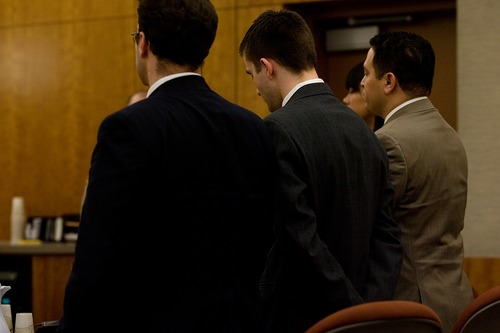 Mark Johnston     Daily Herald Martin Bond, center, hangs his head when the guilty verdict is read on the aggravated murder charge Friday in 4th Judicial District Court in American Fork Friday, Jan. 18, 2013. Bond was found guilty of killing former BYU professor Kay Mortensen in November 2009.