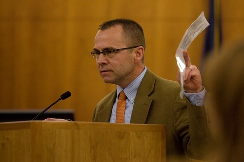 Mark Johnston     Daily Herald Prosecutor Tim Taylor holds up a piece of evidence during his closing statement to the jury at the trial of Martin Bond in 4th District Court in American Fork Friday. Bond was found guilty of killing former BYU professor Kay Mortensen in November 2009.