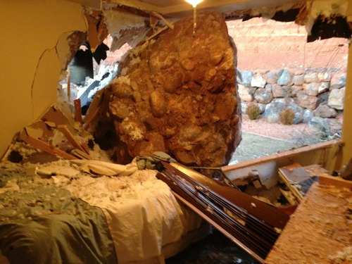 Scot Denhalter | Courtesy A boulder crashed through the home of Scot and Wanda Denhalter in St. George at about 3 a.m. Saturday. Wanda Denhalter suffered a broken jaw and sternum and had to have emergency surgery. The boulder is an oblong shape and is about 12 feet long and 9 feet high.
