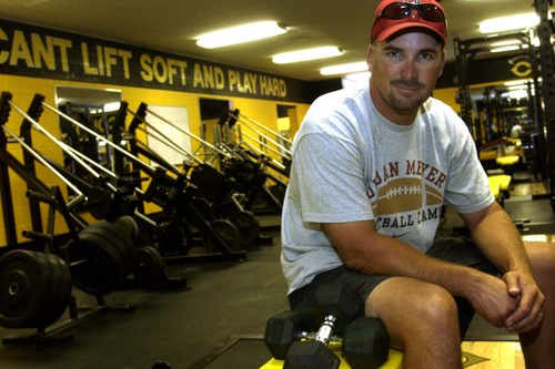 """Tribune file photo In this 2004 photo, former U. of U. quarterback Scott Cate sits in the Cottonwood High weight room after he paid for a major renovation. Cate, who donated millions of dollars to the school, said he will give no more money now that the Granite School District is more involved in the process. """"Every time the district stuck their nose into one of my projects … the cost went up three times,"""" Cate said."""