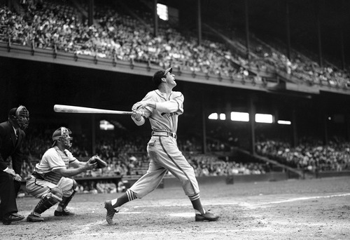 FILE - In this May 22, 1946 file photo, St. Louis Cardinals' Stan Musial bats against the Philadelphia Phillies during a baseball game at Shibe Park in Philadelphia, Pa. Musial, one of baseball's greatest hitters and a Hall of Famer with the Cardinals for more than two decades, died Saturday, Jan 19, 2013, the team announced. He was 92. (AP Photo/Warren M. Winterbottom, File)