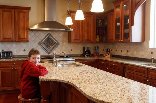 Trent Nelson  |  The Salt Lake Tribune Logan Bennett in his family's kitchen. Home seller Melisa Bennett has readied her Draper home for sale with help from real estate agent Angie Domichel Nelden.