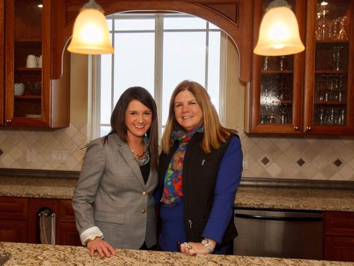 Trent Nelson  |  The Salt Lake Tribune Real estate agents Angie Domichel Nelden and Sally Domichel.