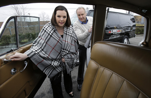 In this Tuesday, Jan. 15, 2013, photo, Joe Brasco and his wife Ann Marie Brasco, of  New Jersey Limo Bus & Limousine, prepare a Rolls Royce in Fairfield, N.J. The flu season has created a scramble for New Jersey Limo Bus & Limousine as two of the company's seven full-time employees called in sick at the same time, but the Brascos have managed to find substitutes when workers have called in sick. (AP Photo/Mel Evans)