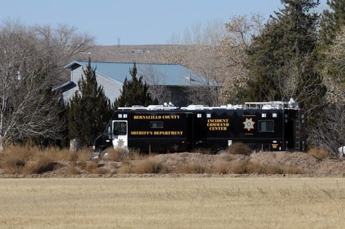 BCSO deputies and crime scene personnel work the scene of a five person homicide on Long Lane SW, in Albuquerque, NM, Sunday, Jan. 20, 2013. Authorities said a teenage boy fatally shot two adults and three children at a home near Albuquerque. (AP Photo/Albuquerque Journal, Pat Vasquez-Cunningham)