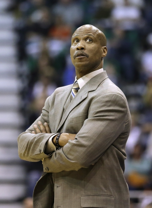 Cleveland Cavaliers head coach Byron Scott looks at the score board in the first quarter during an NBA basketball game against the Utah Jazz Saturday, Jan. 19, 2013, in Salt Lake City. (AP Photo/Rick Bowmer)