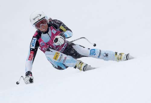Julia Mancuso, of the United States, speeds down the course on her way to clock the fifth fastest time in the first run of an Alpine ski World Cup women's Super G, in Cortina d'Ampezzo, Italy, Sunday, Jan. 20, 2013. (AP Photo/Marco Trovati)
