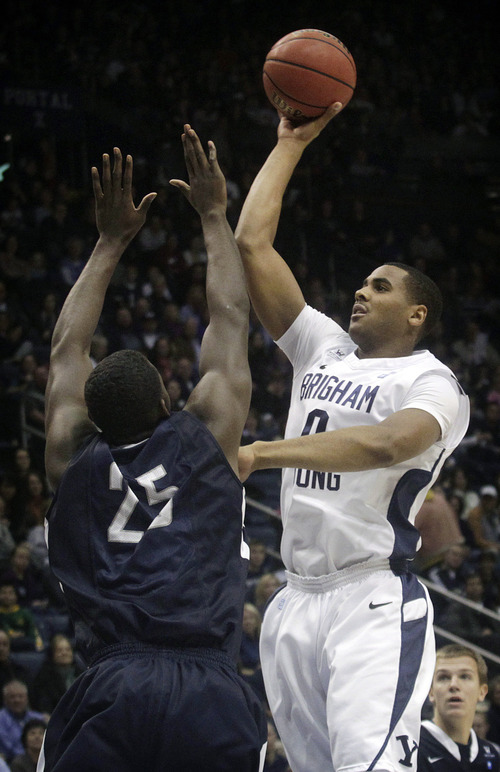 Brigham Young University's Brandon Davies goes up for a basket during the first half of an NCAA college basketball game against San Diego at the Marriott Center in Provo, Utah on Saturday, Jan. 19, 2013.   (AP Photo/Daily Herald, James Roh)