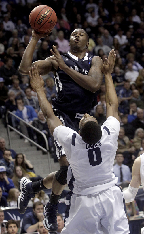 San Diego's Ken Rancifer goes up for a basket during an NCAA college basketball game against BYU at the Marriott Center in Provo, Utah on Saturday, Jan. 19, 2013.   (AP Photo/Daily Herald, James Roh)