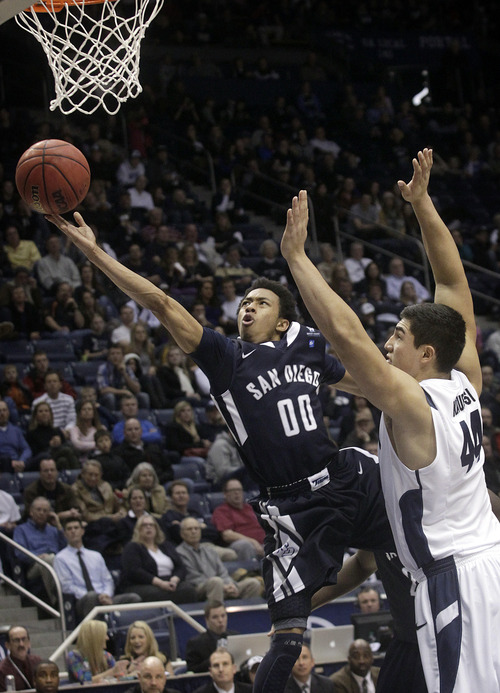 San Diego's Christopher Anderson goes up for a basket during the second half  of an NCAA college basketball game against BYU at the Marriott Center in Provo, Utah on Saturday, Jan. 19, 2013.   (AP Photo/Daily Herald, James Roh)