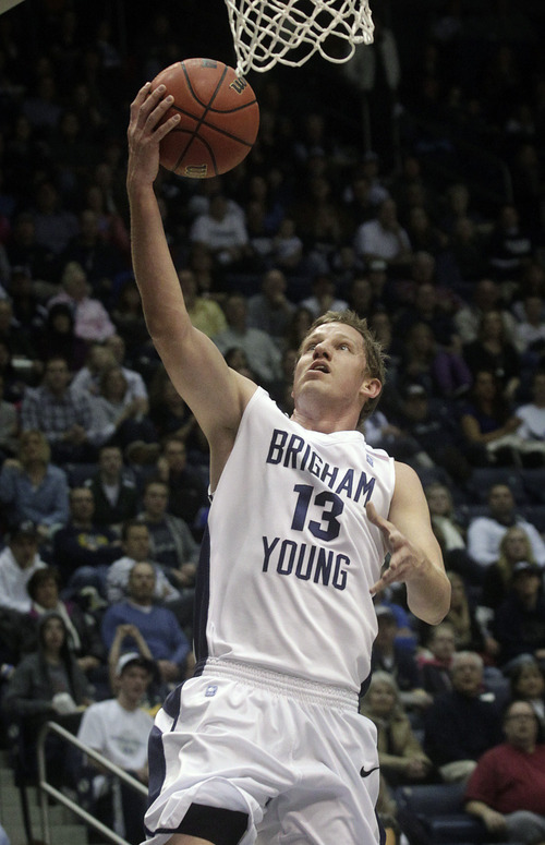 BYU's Brock Zylstra goes up for a basket against San Diego during an NCAA college basketball game in Provo, Utah on Saturday, Jan. 19, 2013. (AP Photo/The Daily Herald, James Roh)