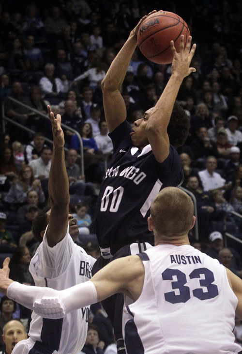 San Diego's Christopher Anderson grabs a rebound during the first half  of an NCAA college basketball game against Brigham Young University at the Marriott Center in Provo, Utah on Saturday, Jan. 19, 2013.   (AP Photo/Daily Herald, James Roh)