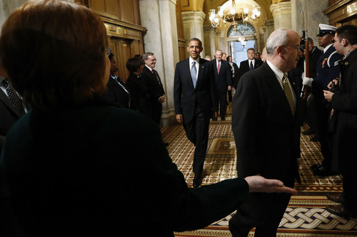 President Barack Obama is directed as he arrives on Capitol Hill in Washington, Monday, Jan. 21,2013, for his ceremonial swearing-in ceremony during the 57th Presidential Inauguration.   (AP Photo/Jonathan Ernst, Pool)