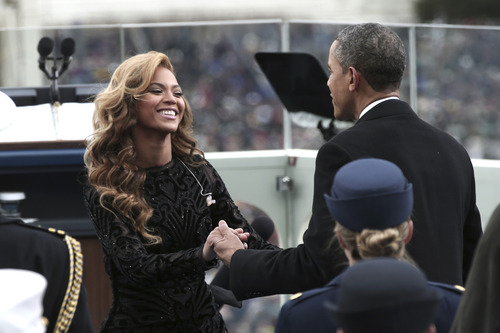 President Barack Obama greets singer Beyonce on the West Front of the Capitol in Washington, Monday, Jan. 21, 2013, after she sang the National Anthem during the president's ceremonial swearing-in ceremony during the 57th Presidential Inauguration.  (AP Photo/Win McNamee, Pool)