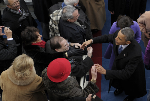 President Barack Obama shakes hands with guests following the ceremonial swearing-in at the U.S. Capitol during the 57th Presidential Inauguration in Washington, Monday, Jan. 21, 2013. (AP Photo/Susan Walsh)
