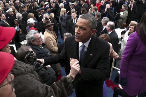 President Barack Obama greets people on the West Front of the Capitol in Washington, Monday, Jan. 21, 2013 in Washington, after the president's ceremonial swearing-in ceremony during the 57th Presidential Inauguration.  (AP Photo/Win McNamee, Pool)
