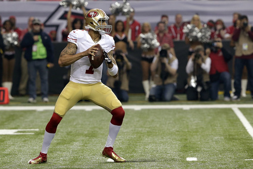 San Francisco 49ers quarterback Colin Kaepernick looks for an opening to pass during the first half of the NFL football NFC Championship game against the Atlanta Falcons Sunday, Jan. 20, 2013, in Atlanta. (AP Photo/Dave Martin)