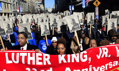 Participants march down Fayetteville Street in Raleigh, N.C., Monday, Jan. 21, 2013, during the 33rd annual Dr. Martin Luther King Jr. parade. (AP Photo/The News & Observer, Travis Long)
