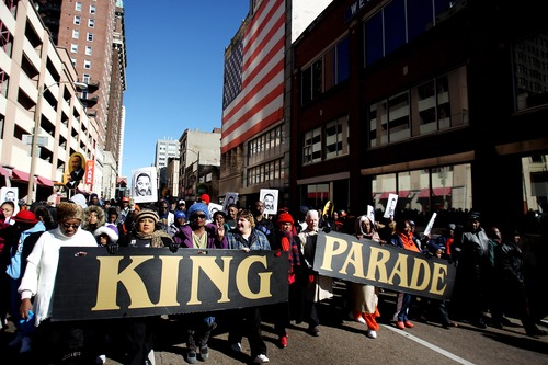 Participants in the 28th annual Martin Luther King Jr. Holiday Parade walk down 2nd Street in Memphis, Tenn. Monday, Jan. 21, 2013. Hundreds marched from the Pinch District to the National Civil Rights Museum to commemorate the birthday of civil rights leader Martin Luther King Jr. (AP Photo/The Commercial Appeal, Mike Brown)