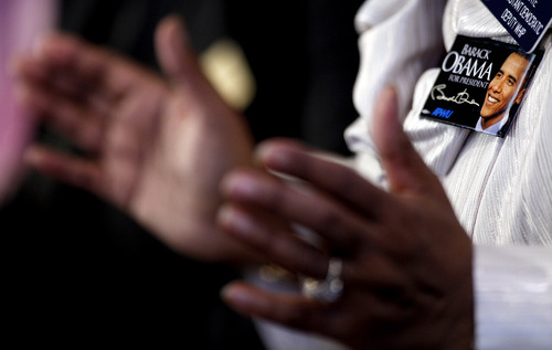 Sen. Donzella James, D-College Park, wears a President Barack Obama pin as she prays during the annual Dr. Martin Luther King Jr. holiday commemorative service at the Ebenezer Baptist Church, Monday, Jan. 21, 2013, in Atlanta. (AP Photo/David Goldman)