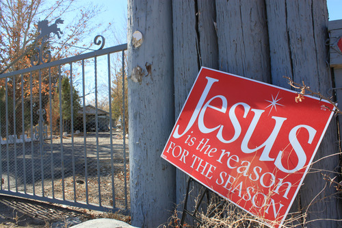 This Jan. 21, 2013, image shows a religious sign at the entrance to a home where a couple and their three young children were found shot to death south of Albuquerque, N.M. The couple's 15-year-old son, Nehemiah Griego, is facing counts of murder and child abuse in connection with the shootings. (AP Photo/Susan Montoya Bryan)