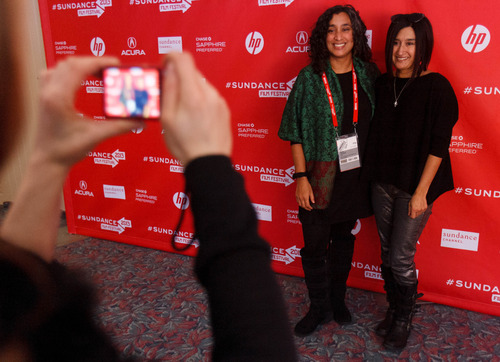 Trent Nelson  |  The Salt Lake Tribune Editor Geeta Gandbhir and her sister Una Gandbhir have a photo taken at the Sundance Film Festival premiere of the film Which Way is the Front Line From Here? The Life and Time of Tim Hetherington, Sunday, January 20, 2013 in Park City.