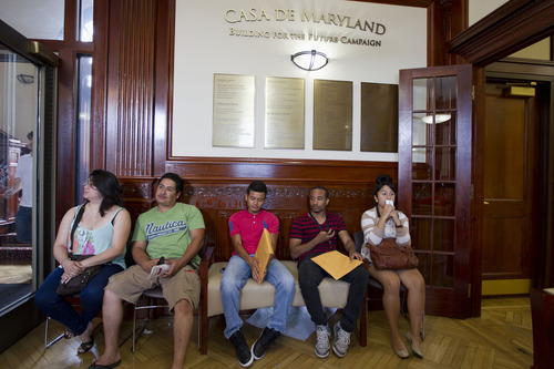 FILE - This Aug. 15, 2012 file photo shows applicants waiting in Casa de Maryland in Langley Park, Md., before they can apply for the Deferred Action Childhood Arrivals, as the U.S. started accepting applications to allow them to avoid deportation and get a work permit _ but not a path to citizenship.  More than 6 in 10 Americans now favor allowing illegal immigrants to eventually become U.S. citizens, a major increase in support driven by a turnaround in Republicans' opinion after the 2012 elections. The finding, in a new Associated Press-GfK poll, comes as Republicans seek to increase their meager support among Latino voters, who turned out in large numbers to help-re-elect President Barack Obama in November.  (AP Photo/Jose Luis Magana, File)