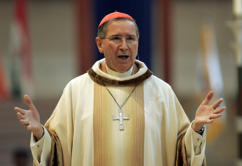 """FILE - In this Sept. 22, 2007 file photo, Cardinal Roger Mahony speaks during an annual multi-ethnic migration Mass at the Cathedral of Our Lady of the Angels in Los Angeles. Cardinal Mahony and other top Roman Catholic officials from the Archdiocese of Los Angeles maneuvered behind the scenes to shield molester priests, provide damage control for the church and keep parishioners in the dark, according to church personnel files. Mahony, who is retired, issued a statement Monday, Jan. 21, 2013, apologizing for his mistakes and saying he had been """"naive"""" about the lasting impacts of abuse. (AP Photo/Reed Saxon, File)"""
