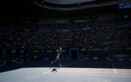 Russia's Maria Sharapova hits a backhand return to compatriot Ekaterina Makarova during their quarterfinal match at the Australian Open tennis championship in Melbourne, Australia, Tuesday, Jan. 22, 2013. (AP Photo/Dita Alangkara)