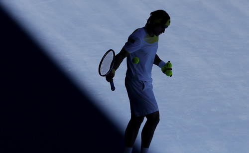 Spain's David Ferrer prepares to serve to compatriot Nicolas Almagro during their quarterfinal match at the Australian Open tennis championship in Melbourne, Australia, Tuesday, Jan. 22, 2013. (AP Photo/Andy Wong)