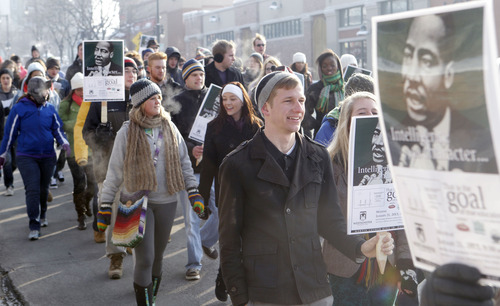 Al Hartmann  |  The Salt Lake Tribune About 100 hundred people brave the cold Monday, Jan. 21, to sing and march down 2100 South in honor of Martin Luther King Day.   The celebration started at Westminster College followed by a march through Sugar House and back to the college where they assembled hygiene kits for the Crossroads Urban Center.
