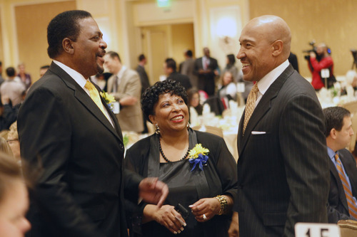 Al Hartmann  |  The Salt Lake Tribune Edward L. Lewis, Chairman of the Martin Luther King Jr. Memorial Luncheon, left, talks with Jeanetta Williams, President NAACP, Salt Lake Branch and Ron Boone, former NBA player and Jazz broadcaster at a tribute to Dr. Martin Luther King Jr. and Rosa Parks at Little America Monday January 21.