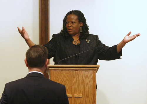 Rick Egan  | The Salt Lake Tribune   Granger Christian Church Minister Pastor Vinnetta Golphin-Wilkes says a prayer  during a special, multi-denominational event in honor of Martin Luther King, in West Valley, Monday, January 21, 2013.