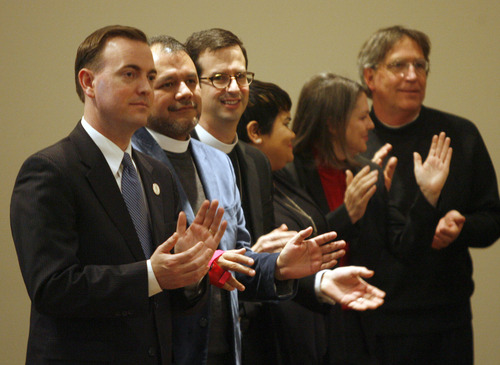 Rick Egan  | The Salt Lake Tribune   West Valley City mayor, Mike Winder (left) claps along with others on the front row, as the Granger youth choir sings at the Granger Christian Church during a special, multi-denominational event in honor of Martin Luther King, in West Valley, Monday, January 21, 2013.