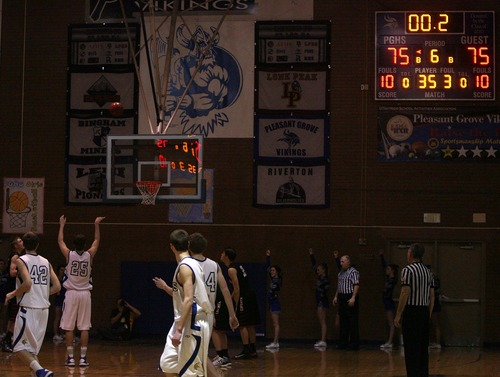 Leah Hogsten  |  The Salt Lake Tribune Pleasant Grove's Matt Conway sinks the second foul shot with .02seconds left in the second overtime. Pleasant Grove High School defeated American Fork 76-75 during the buzzer of the second overtime Tuesday, January 22, 2013.