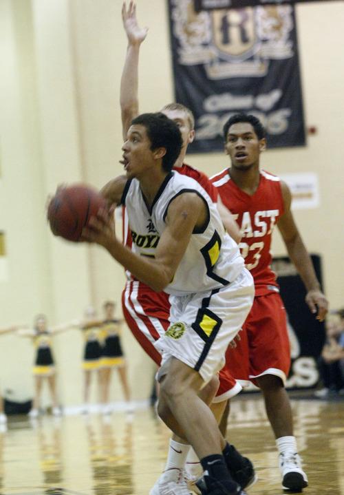 Chris Detrick  |  The Salt Lake Tribune Roy's Brekkott Chapman (23) shoots past East's Parker Van Dyke (5) during the game at Roy High School Friday January 4, 2013.