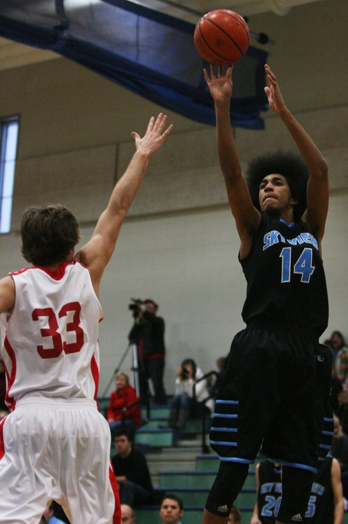 Kim Raff  |  The Salt Lake Tribune East player Mitch Grant defends Sky View player Jalen Moore shoots the ball during the Jordan Holiday Torney at Juan Diego High School in Draper on December 27, 2012. East went on to win the game 64-46.