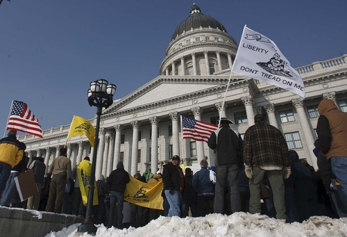 Leah Hogsten  |  The Salt Lake Tribune Pro-gun activists rallied at the Utah Capitol on Saturday, January 19, 2013, to support the right to own firearms they say is under attack from President Barack Obama's proposals to reduce gun violence.The rallies, to be held mostly at state capitals, were being organized by a group called Guns Across America.