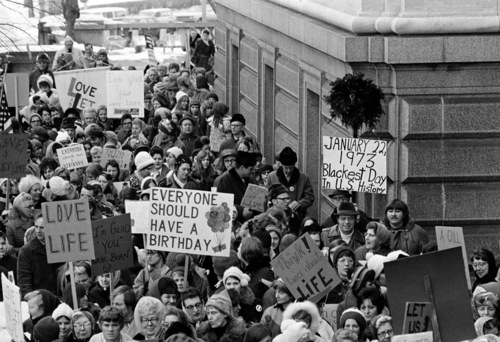 "An estimated 5,000 people, women and men, march around the Minnesota Capitol building protesting the U.S. Supreme Court's Roe v. Wade decision, ruling against state laws that criminalize abortion, in St. Paul, Minn., Jan. 22, 1973.  The marchers formed a ""ring of life"" around the building.  (AP Photo)"