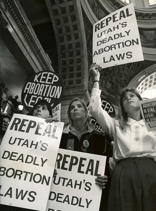 """Veronique Markewitz, left, Sue Schaumburg and Beth Marrett were part of a group of about 100 pro-choice activists demonstrating in a rally at the Capitol in Dec. 1991. They were surrounded by a much larger group of 450 pro-life demonstrators chanting, """"No more. No more."""" Legislators were considering changes in Utah's abortion laws. Steve Griffin  