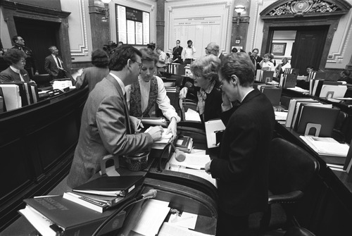 Lawmakers and staff strategize in 1991 as they pass an abortion law that would later be found unconstitutional.| Tribune FIle Photo
