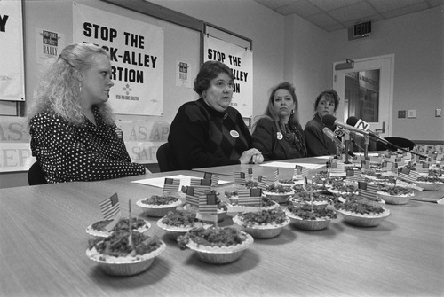 """Karrie Galloway of Planned Parenthood of Utah, second from left, at a press conference. Pro-choice advocates gave lawmakers miniature apple pies and reminded them """"choice was as American as apple pie.""""