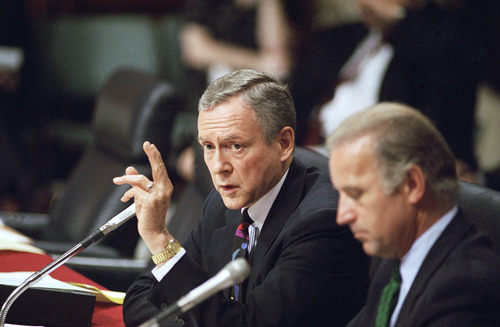 Sen. Orrin Hatch, R-Utah, questions Supreme Court nominee Ruth Bader Ginsburg during her confirmation hearing before the Senate Judiciary Committee at Capital Hill on Thursday, July 22, 1993 in Washington. Hatch questioned Ginsburg sharply on her belief in the constitutional right to abortion. Sen. Joseph Biden, D-Del., chairman of the committee is at right. (AP Photo/Charles Tasandi)