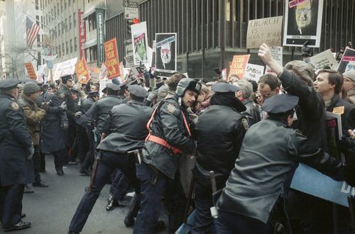 Police keep AIDS and pro-choice groups demonstrating outside of St. Patrick's Cathedral behind barriers, Dec. 10, 1989, in New York.  The groups are protesting the Catholic Church's stance on AIDS and abortion. (AP Photo/Frankie Ziths)