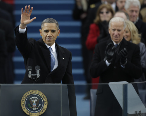 President Barack Obama waves after his speech while Vice President Joe Biden applauds at the ceremonial swearing-in at the U.S. Capitol during the 57th Presidential Inauguration in Washington, Monday, Jan. 21, 2013. (AP Photo/Pablo Martinez Monsivais)