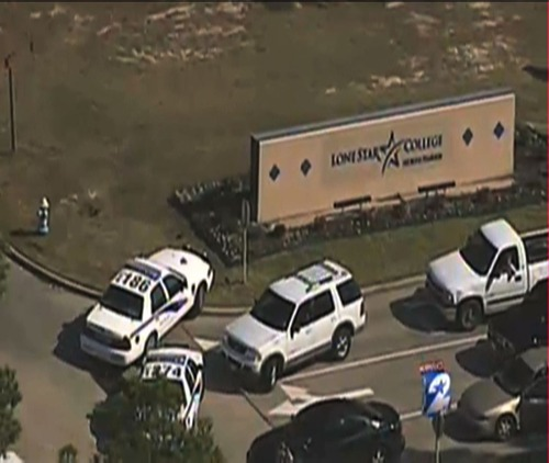 In this frame grab provided by KPRC Houston, police vehicles block an entrance to Lone Star College Tuesday, Jan. 22, 2013, in Houston, where law enforcement officials say the community college is on lockdown amid reports of a shooter on campus.  (AP Photo/Courtesy KPRC TV) MANDATORY CREDIT